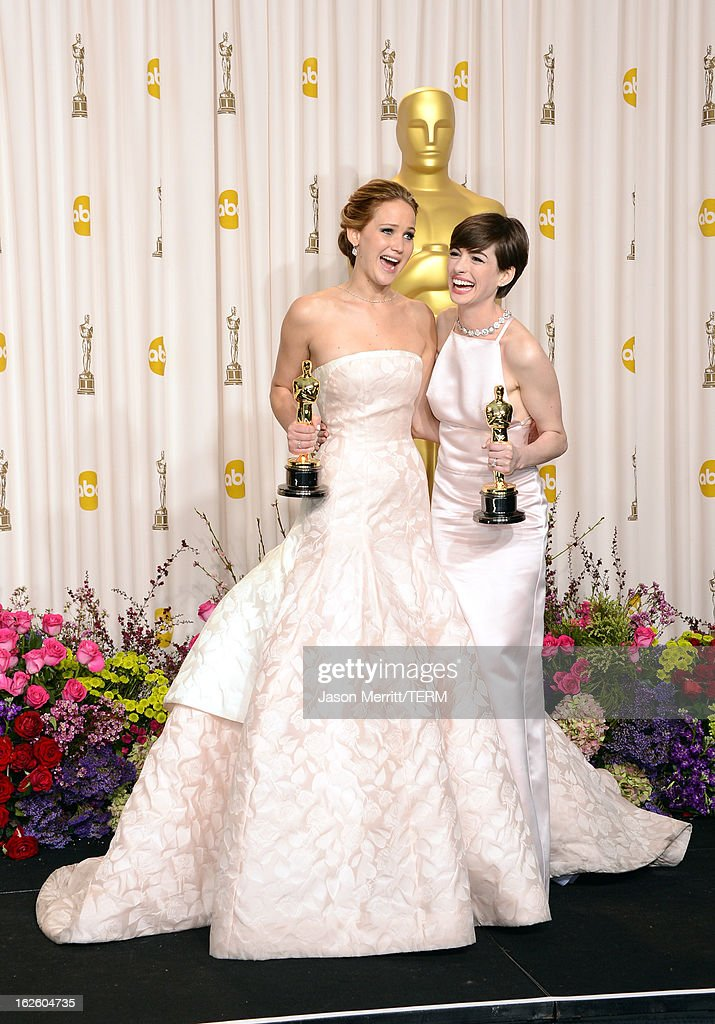 Actresses <a gi-track='captionPersonalityLinkClicked' href=/galleries/search?phrase=Jennifer+Lawrence&family=editorial&specificpeople=1596040 ng-click='$event.stopPropagation()'>Jennifer Lawrence</a> (L), winner of the Best Actress award for 'Silver Linings Playbook,' and <a gi-track='captionPersonalityLinkClicked' href=/galleries/search?phrase=Anne+Hathaway+-+Schauspielerin&family=editorial&specificpeople=11647173 ng-click='$event.stopPropagation()'>Anne Hathaway</a>, winner of the Best Supporting Actress award for 'Les Miserables,' pose in the press room during the Oscars held at Loews Hollywood Hotel on February 24, 2013 in Hollywood, California.
