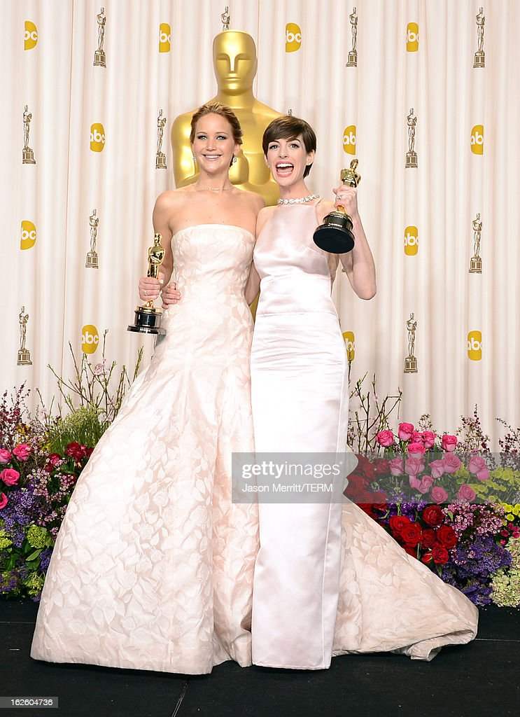 Actresses <a gi-track='captionPersonalityLinkClicked' href=/galleries/search?phrase=Jennifer+Lawrence&family=editorial&specificpeople=1596040 ng-click='$event.stopPropagation()'>Jennifer Lawrence</a> (L), winner of the Best Actress award for 'Silver Linings Playbook,' and <a gi-track='captionPersonalityLinkClicked' href=/galleries/search?phrase=Anne+Hathaway+-+Actress&family=editorial&specificpeople=11647173 ng-click='$event.stopPropagation()'>Anne Hathaway</a>, winner of the Best Supporting Actress award for 'Les Miserables,' pose in the press room during the Oscars held at Loews Hollywood Hotel on February 24, 2013 in Hollywood, California.