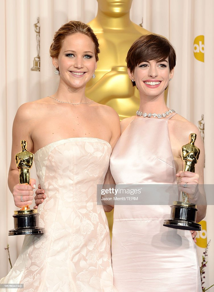Actresses Jennifer Lawrence (L), winner of the Best Actress award for 'Silver Linings Playbook,' and Anne Hathaway, winner of the Best Supporting Actress award for 'Les Miserables,' pose in the press room during the Oscars held at Loews Hollywood Hotel on February 24, 2013 in Hollywood, California.