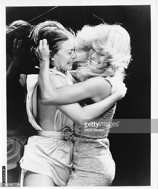 Actresses Jenny Agutter and Farrah Fawcett in a fight scene from the dystopian science fiction film 'Logan's Run' 1976