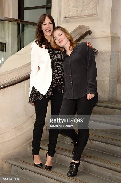 Actresses Jessica Brown Findlay and Holliday Grainger pose at a photocall for 'The Riot Club' at the Corinthia Hotel in London on September 10 2014...