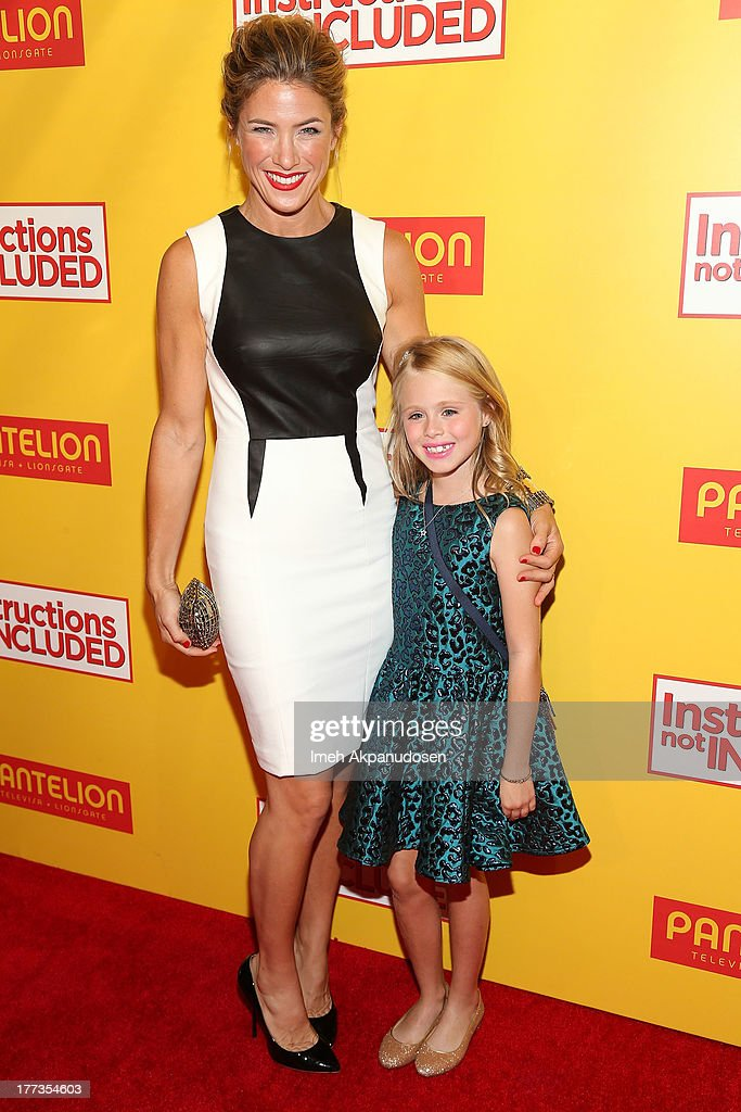 Actresses Jessica Lindsey (L) and Loreto Peralta attend the premiere of Pantelion Films' 'Instructions Not Included' at TCL Chinese Theatre on August 22, 2013 in Hollywood, California.
