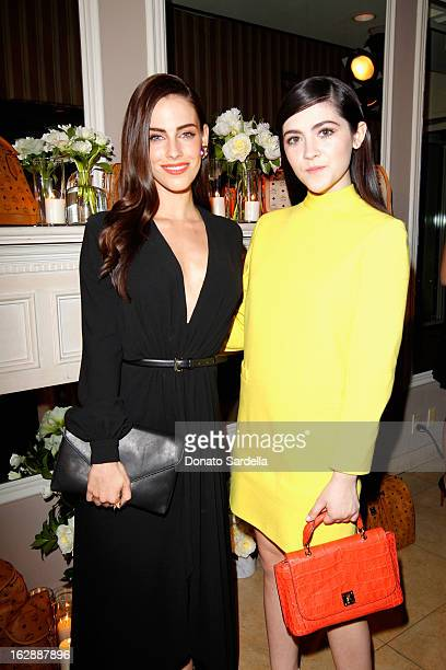 Actresses Jessica Lowndes and Isabelle Fuhrman attend the Dukes Of Melrose launch hosted by Decades Harper's BAZAAR and MCM on February 28 2013 in...