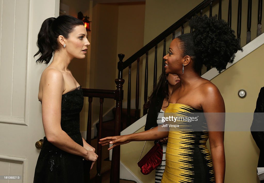 Actresses Jessica Paré and Teyonah Parris attend Vanity Fair and Maybelline toast to 'Mad Men' at Chateau Marmont on September 20, 2013 in Los Angeles, California.