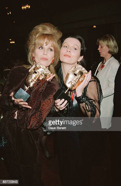 Actresses Joanna Lumley and Jennifer Saunders at the BAFTAs holding their awards for 'Absolutely Fabulous' 21st March 1993