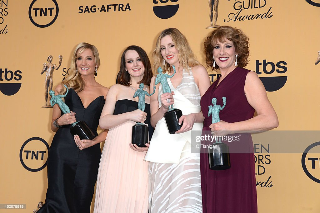 Actresses Joanne Froggatt, Sophie McShera, Laura Carmichael, and Phyllis Logan, winners of Outstanding Performance by an Ensemble in a Drama Series for 'Downton Abbey,' pose in the press room during the 21st Annual Screen Actors Guild Awards at The Shrine Auditorium on January 25, 2015 in Los Angeles, California.