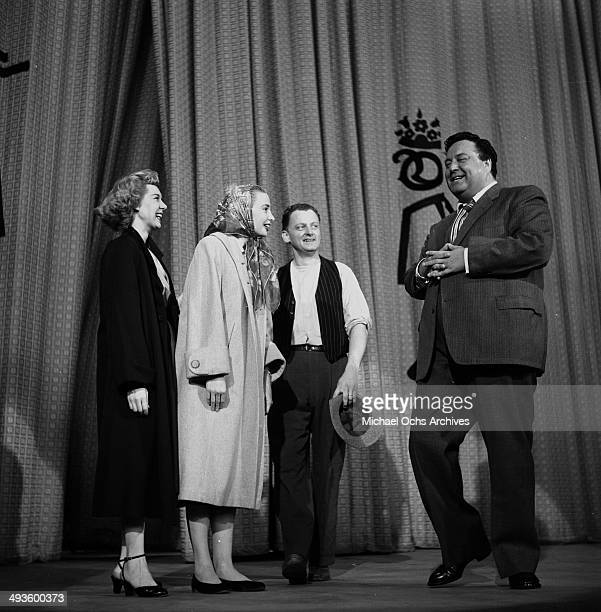 Actresses Joyce Randolph Audrey Meadows actors Art Carney and and Jackie Gleason on stage after the 'The Jackie Gleason Show' in Los Angeles...