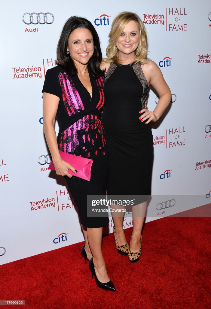Actresses <a gi-track='captionPersonalityLinkClicked' href=/galleries/search?phrase=Julia+Louis-Dreyfus&family=editorial&specificpeople=208965 ng-click='$event.stopPropagation()'>Julia Louis-Dreyfus</a> (L) and <a gi-track='captionPersonalityLinkClicked' href=/galleries/search?phrase=Amy+Poehler&family=editorial&specificpeople=228430 ng-click='$event.stopPropagation()'>Amy Poehler</a> arrive at the The Television Academy's 23rd Hall Of Fame Induction Gala at The Regent Beverly Wilshire Hotel on March 11, 2014 in Beverly Hills, California.