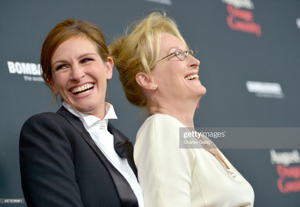 Actresses Julia Roberts (L) and Meryl Streep attend the LA premiere Of 'August: Osage County' presented by The Weinstein Company in partnership with Bombardier at Regal Cinemas L.A. Live on December 16, 2013 in Los Angeles, California.