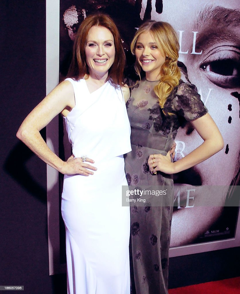Actresses <a gi-track='captionPersonalityLinkClicked' href=/galleries/search?phrase=Julianne+Moore&family=editorial&specificpeople=171555 ng-click='$event.stopPropagation()'>Julianne Moore</a> (L) and Chloe Grace Moretz attend the premiere of 'Carrie' on October 7, 2013 at ArcLight Hollywood in Hollywood, California.