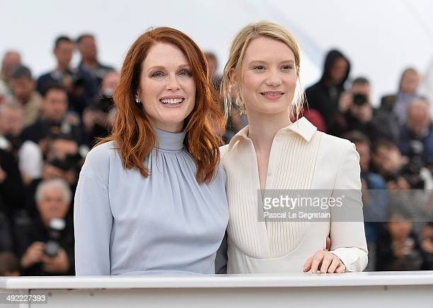 Actresses Julianne Moore and Mia Wasikowska attend the 'Maps To The Stars' photocall during the 67th Annual Cannes Film Festival on May 19 2014 in...