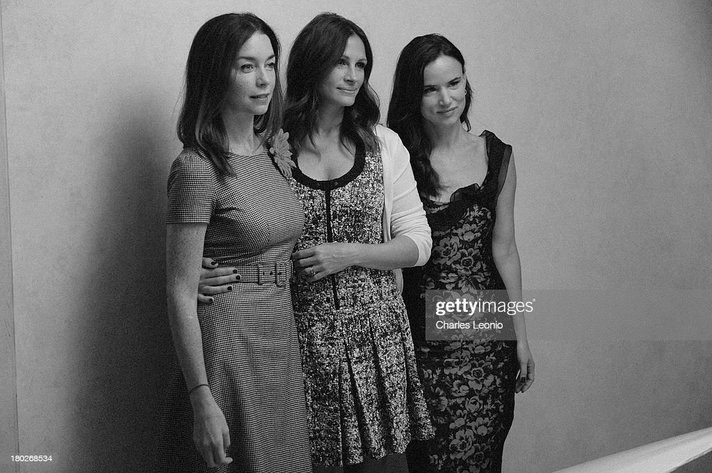 Actresses Julianne Nicholson, Julia Roberts and Juliette Lewis poses for a portrait with photographer Jeff Vespa during the 2013 Toronto International Film Festival on September 10, 2013 in Toronto, Canada.