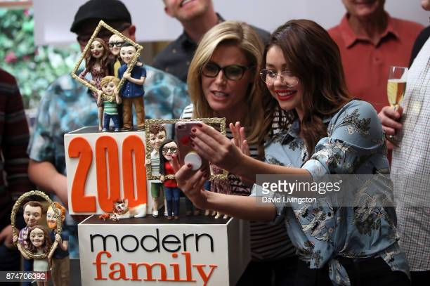 Actresses Julie Bowen and Sarah Hyland pose for a selfie at the ABC celebration of the 200th episode of 'Modern Family' at Fox Studios on November 15...