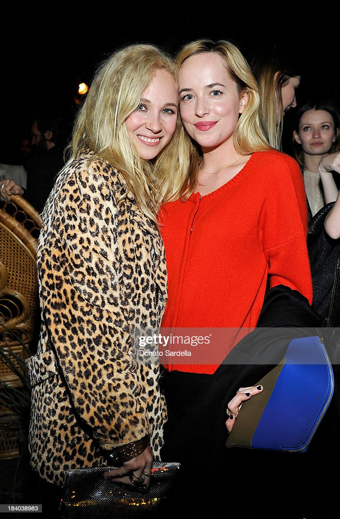 Actresses <a gi-track='captionPersonalityLinkClicked' href=/galleries/search?phrase=Juno+Temple&family=editorial&specificpeople=4692912 ng-click='$event.stopPropagation()'>Juno Temple</a> and Dakoda Johnson attends Isabel Marant & Milla Jovovich BBQ party to celebrate the 1st Year of he LA Shop at Isabel Marant on October 10, 2013 in Los Angeles, California.