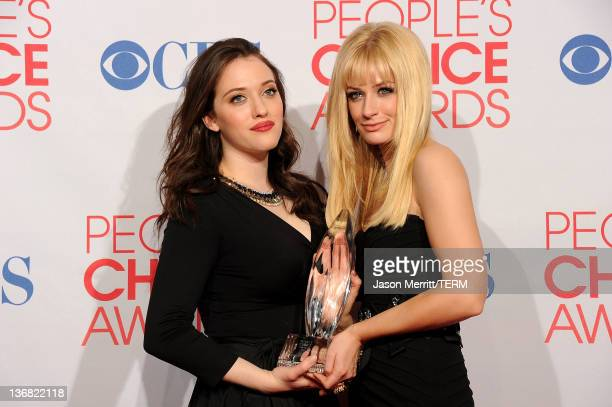 Actresses Kat Dennings and Beth Behrs pose with Favorite New TV Comedy for '2 Broke Girls' in the press room during the 2012 People's Choice Awards...