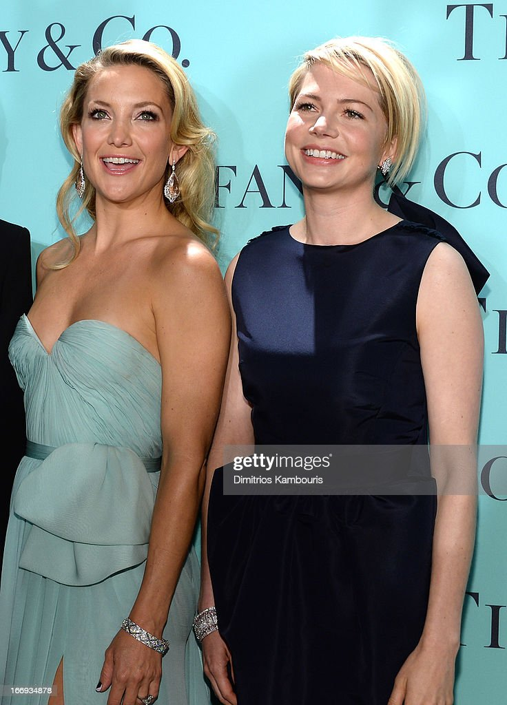 Actresses (L-R) Kate Hudson and Michelle Williams are wearing Diamonds from the Tiffany & Co. 2013 Blue Book Collection at the Tiffany & Co. Blue Book Ball at Rockefeller Center on April 18, 2013 in New York City.