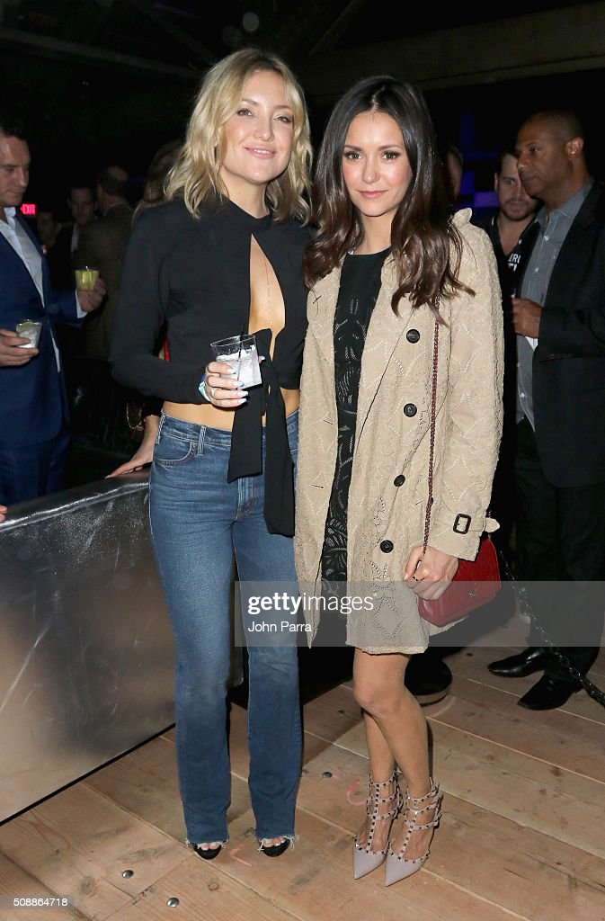 Actresses Kate Hudson and Nina Dobrev attend the DirecTV and Pepsi Super Saturday Night featuring Red Hot Chili Peppers at Pier 70 on February 6 2016...