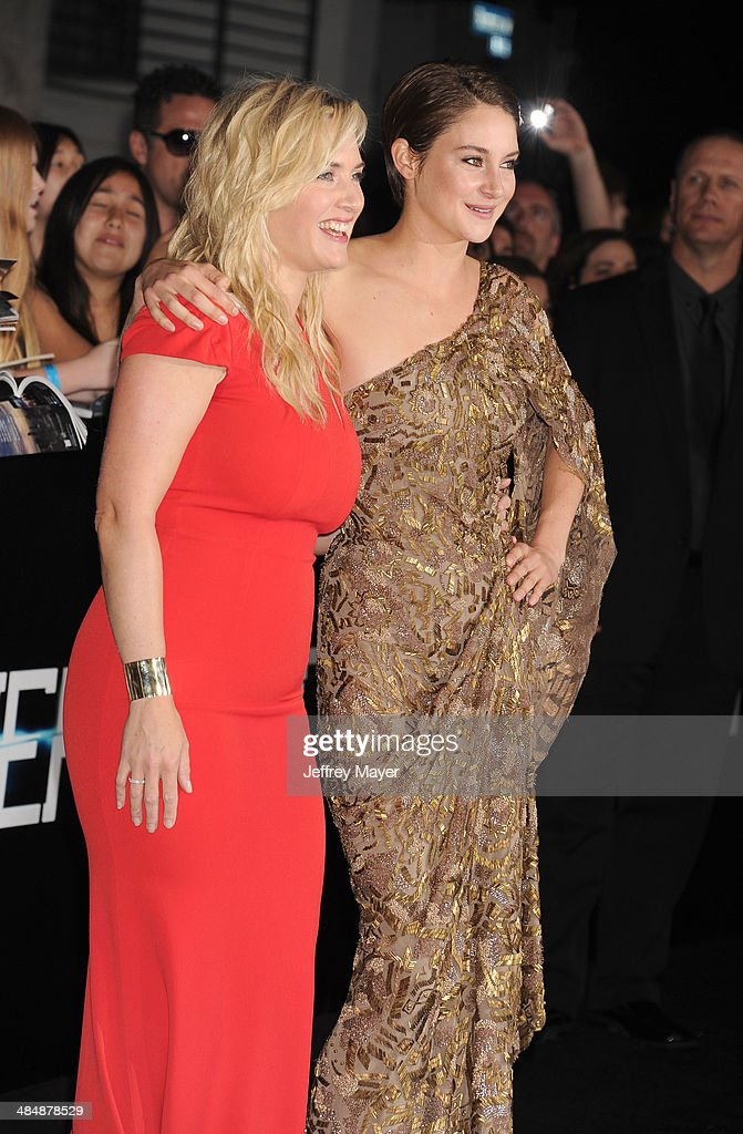 Actresses <a gi-track='captionPersonalityLinkClicked' href=/galleries/search?phrase=Kate+Winslet&family=editorial&specificpeople=201923 ng-click='$event.stopPropagation()'>Kate Winslet</a> (L) and <a gi-track='captionPersonalityLinkClicked' href=/galleries/search?phrase=Shailene+Woodley&family=editorial&specificpeople=676833 ng-click='$event.stopPropagation()'>Shailene Woodley</a> arrive at the Los Angeles premiere of 'Divergent' at Regency Bruin Theatre on March 18, 2014 in Los Angeles, California.