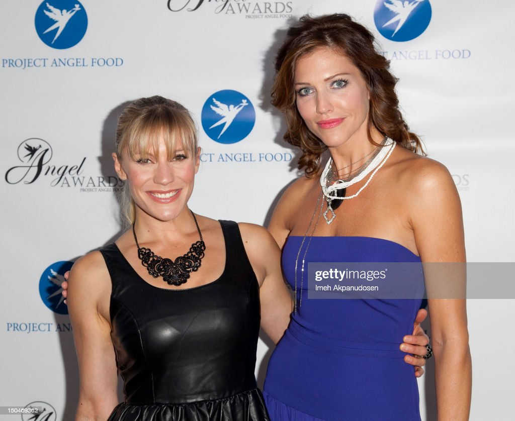 Actresses Katee Sackhoff (L) and Tricia Helfer attend Project Angel Food's 17th Annual Angel Awards at Project Angel Food on August 18, 2012 in Los Angeles, California.