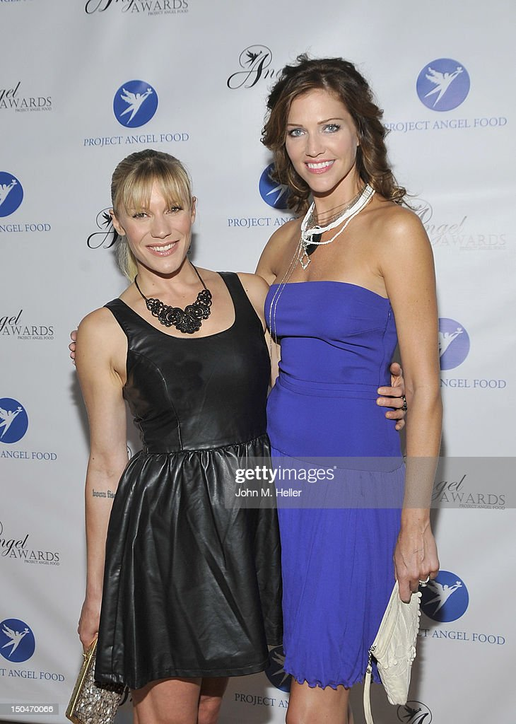 Actresses Katee Sackhoff and Tricia Helfer attend the 17th Annual Angel Awards at Project Angel Food on August 18, 2012 in Los Angeles, California.