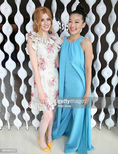 Actresses Katherine McNamara and Arden Cho attend the Wolk Morais Collection 3 Fashion Show on May 24 2016 in Los Angeles California