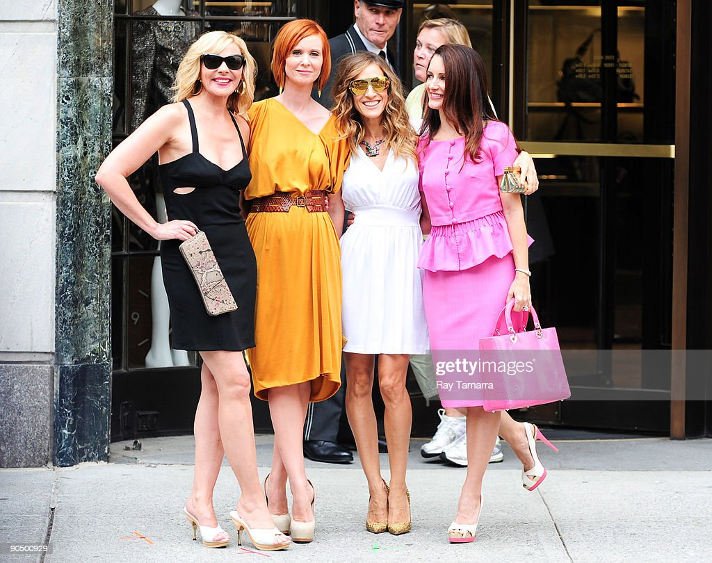 Actresses Kim Cattrall, Cynthia Nixon, Sarah Jessica Parker, and Kristen Davis pose for photos on location at the 'Sex And The City 2' film set at Bergdorf Goodman on September 09, 2009 in New York City.
