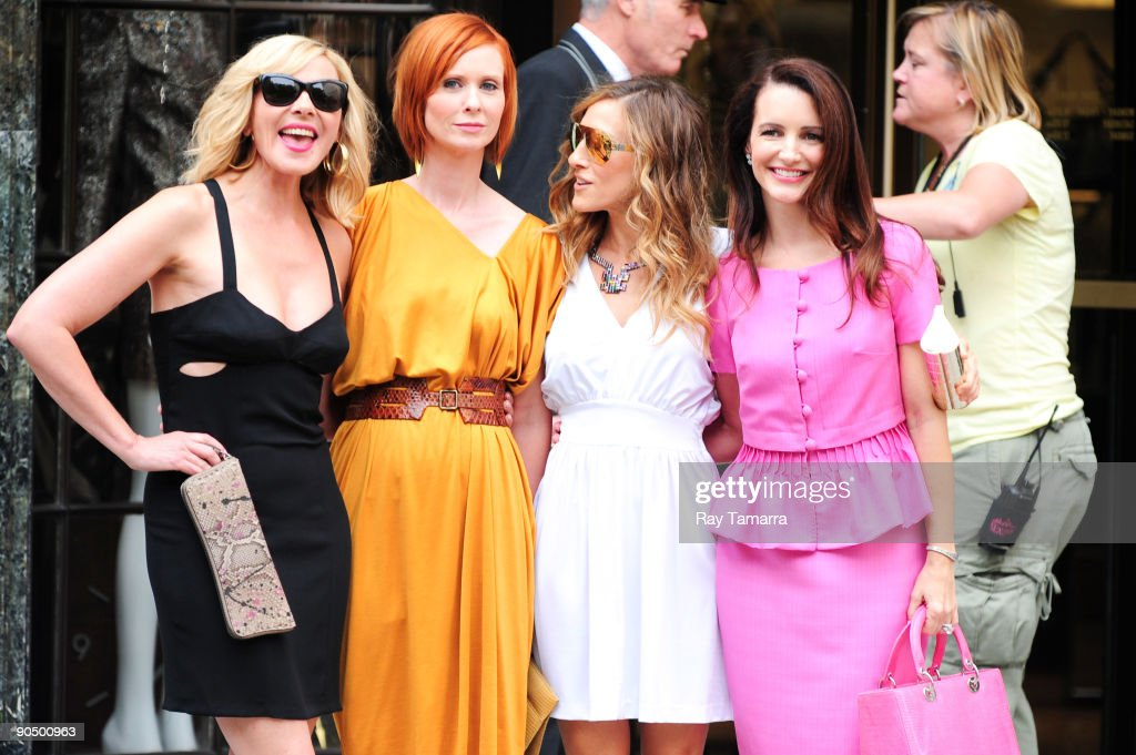 Actresses Kim Cattrall, Cynthia Nixon, <a gi-track='captionPersonalityLinkClicked' href=/galleries/search?phrase=Sarah+Jessica+Parker&family=editorial&specificpeople=201693 ng-click='$event.stopPropagation()'>Sarah Jessica Parker</a>, and Kristen Davis pose for photos on location at the 'Sex And The City 2' film set at Bergdorf Goodman on September 09, 2009 in New York City.