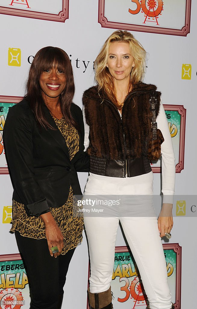 Actresses Kim McCoy and Leigh Collier attends Charlie Ebersol's 'Charlieland' Birthday Party And Charity: Water Fundraiser on December 8, 2012 in Los Angeles, California.