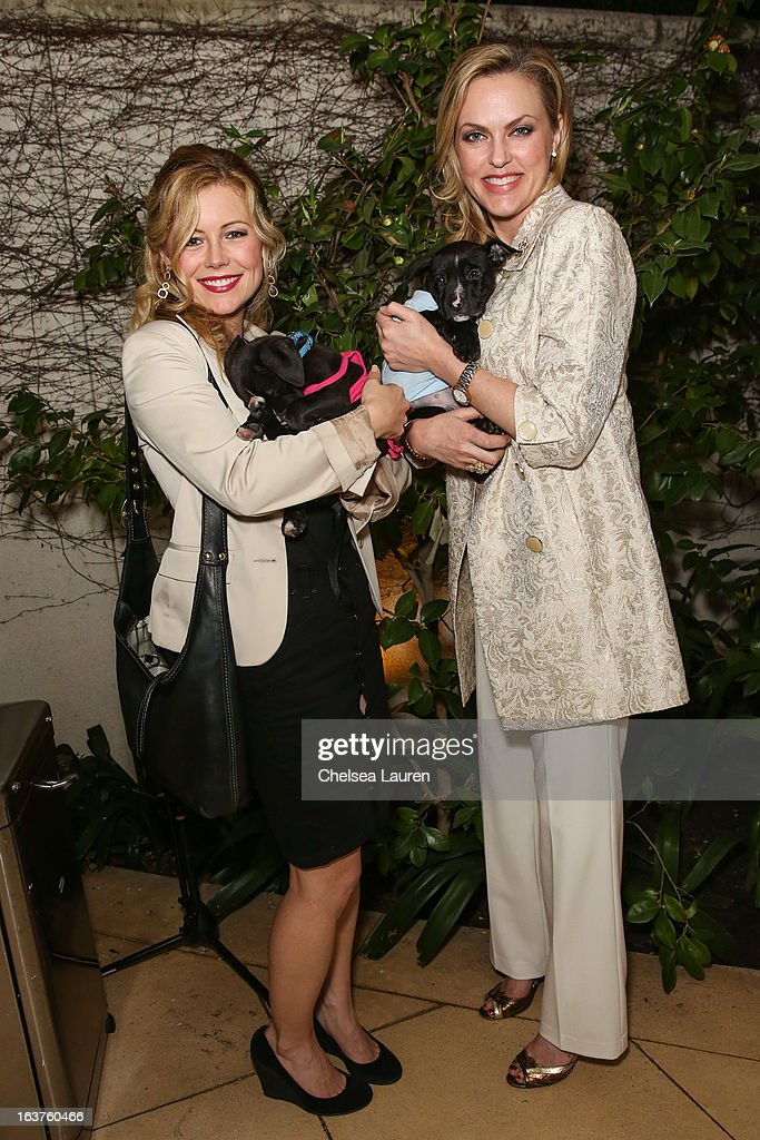 Actresses Kim Poirier (L) and <a gi-track='captionPersonalityLinkClicked' href=/galleries/search?phrase=Elaine+Hendrix&family=editorial&specificpeople=584608 ng-click='$event.stopPropagation()'>Elaine Hendrix</a> pose with dogs wearing Lyric Culture for PetSmart at Much Love Animal Rescue's makeovers for mutts at Peninsula Hotel on March 14, 2013 in Beverly Hills, California.