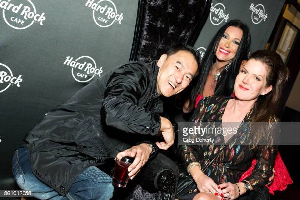 Actresses Kira Reed Lorsch and Taimie Hannum pose for a picture with a guest at their Kira Reed and Taimie Hannum Double Birthday Bash at Hard Rock...