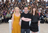 Actresses Kirsten Dunst director Lars Von Trier and Charlotte Gainsbourg attends the 'Melancholia' photocall at the Palais des Festivals during the...