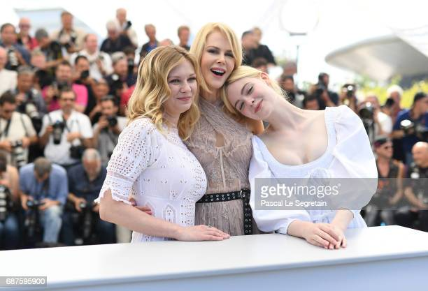 Actresses Kirsten Dunst Nicole Kidman and Elle Fanning attend 'The Beguiled' photocall during the 70th annual Cannes Film Festival at Palais des...
