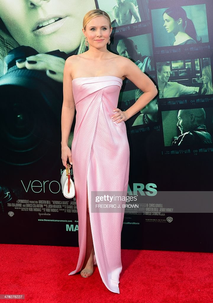 Actresses Kristen Bell poses on arrival for the film premiere of 'Veronica Mars' in Hollywood, California on March 12, 2014. The film opens on March 14. AFP PHOTO/Frederic J. BROWN