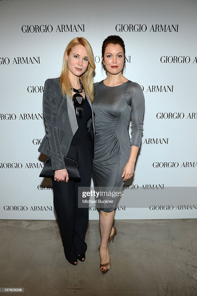 Actresses Kristen Hager, wearing Emporio Armani (L) and <a gi-track='captionPersonalityLinkClicked' href=/galleries/search?phrase=Bellamy+Young&family=editorial&specificpeople=4135230 ng-click='$event.stopPropagation()'>Bellamy Young</a>, wearing Giorgio Armani attend the Giorgio Armani Beauty Luncheon on December 6, 2012 in Beverly Hills, California.