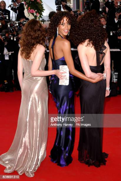 Actresses Laetita Casta Noemie Lenoir and Andie MacDowell arriving for the premiere of The Matrix Reloaded at the Palais des Festival in Cannes