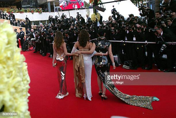 Actresses Laetitia Casta Gong Li and Actress Aishwarya Rai arrive at the 57th International Cannes Film Festival Opening Ceremony and screening of...