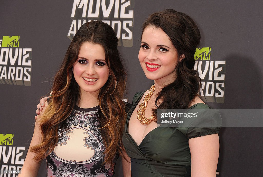 Actresses Laura Marano and Vanessa Marano arrive at the 2013 MTV Movie Awards at Sony Pictures Studios on April 14, 2013 in Culver City, California.