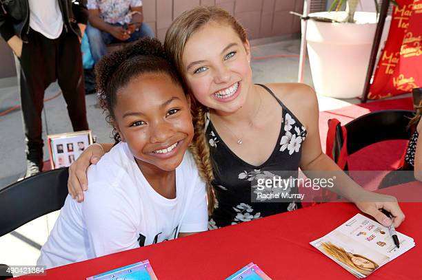 Actresses Laya Hayes and Caitlin Carmichael sign autographs for fans during Merlin's Magic Wand Children's Charity and Madame Tussauds Hollywood...