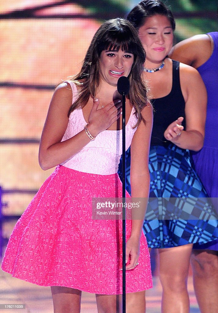 Actresses Lea Michele (L) and Jenna Ushkowitz accept Choice TV Show: Comedy award for 'Glee' onstage during the Teen Choice Awards 2013 at Gibson Amphitheatre on August 11, 2013 in Universal City, California.