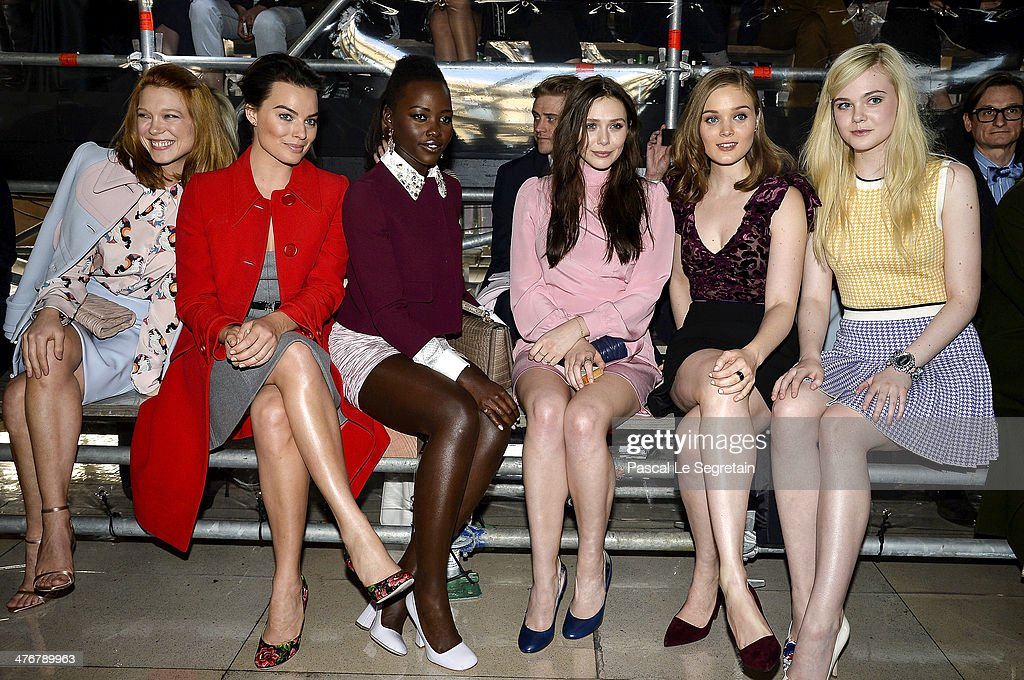 Actresses Lea Seydoux, <a gi-track='captionPersonalityLinkClicked' href=/galleries/search?phrase=Margot+Robbie&family=editorial&specificpeople=5781742 ng-click='$event.stopPropagation()'>Margot Robbie</a>, <a gi-track='captionPersonalityLinkClicked' href=/galleries/search?phrase=Lupita+Nyong%27o&family=editorial&specificpeople=10961876 ng-click='$event.stopPropagation()'>Lupita Nyong'o</a>, <a gi-track='captionPersonalityLinkClicked' href=/galleries/search?phrase=Elizabeth+Olsen&family=editorial&specificpeople=5775031 ng-click='$event.stopPropagation()'>Elizabeth Olsen</a>, <a gi-track='captionPersonalityLinkClicked' href=/galleries/search?phrase=Bella+Heathcote&family=editorial&specificpeople=6890694 ng-click='$event.stopPropagation()'>Bella Heathcote</a> and <a gi-track='captionPersonalityLinkClicked' href=/galleries/search?phrase=Elle+Fanning&family=editorial&specificpeople=2189940 ng-click='$event.stopPropagation()'>Elle Fanning</a> attend the Miu Miu show as part of the Paris Fashion Week Womenswear Fall/Winter 2014-2015 on March 5, 2014 in Paris, France.