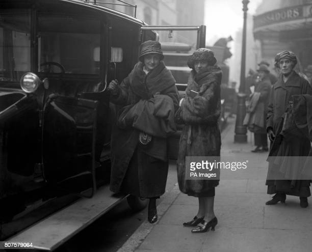 Actresses Lilian Braithwaite and Meggie Albanesi board a taxi outside the St Martin's Theatre in London