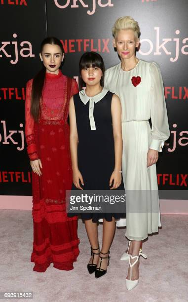 Actresses Lily Collins Ahn Seohyun and Tilda Swinton attend the New York premiere of 'Okja' hosted by Netflix at AMC Lincoln Square Theater on June 8...