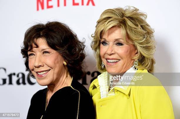Actresses Lily Tomlin and Jane Fonda arrive at the premiere of Netflix's 'Grace and Frankie' at the Regal Cinemas LA Live on April 29 2015 in Los...