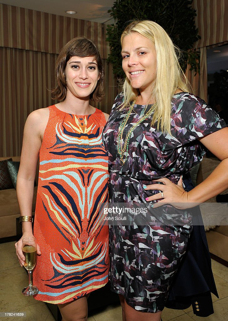 Actresses Lizzy Caplan (L) and Busy Philipps celebrate the release of Ali Larter's new cookbook 'Kitchen Revelry' with Perrier-Jouet at Sunset Tower on August 27, 2013 in West Hollywood, California.