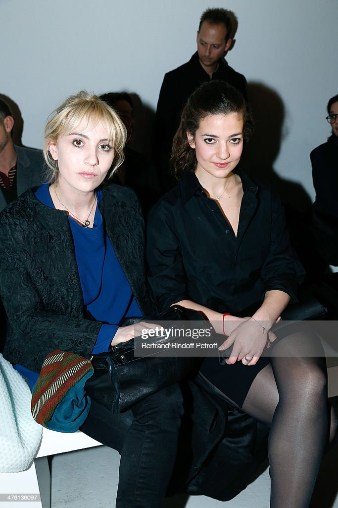 Actresses Lolita Chammah and <a gi-track='captionPersonalityLinkClicked' href=/galleries/search?phrase=Esther+Garrel&family=editorial&specificpeople=7784458 ng-click='$event.stopPropagation()'>Esther Garrel</a> attend the John Galliano show as part of the Paris Fashion Week Womenswear Fall/Winter 2014-2015 on March 2, 2014 in Paris, France.