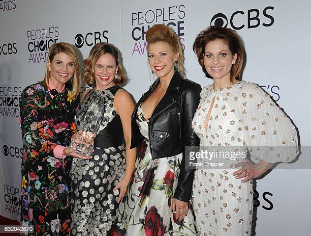 Actresses Lori Loughlin Andrea Barber Jodie Sweetin and Candace Cameron Bure winners of the Favorite Premium Comedy Series Award 'Fuller House' pose...