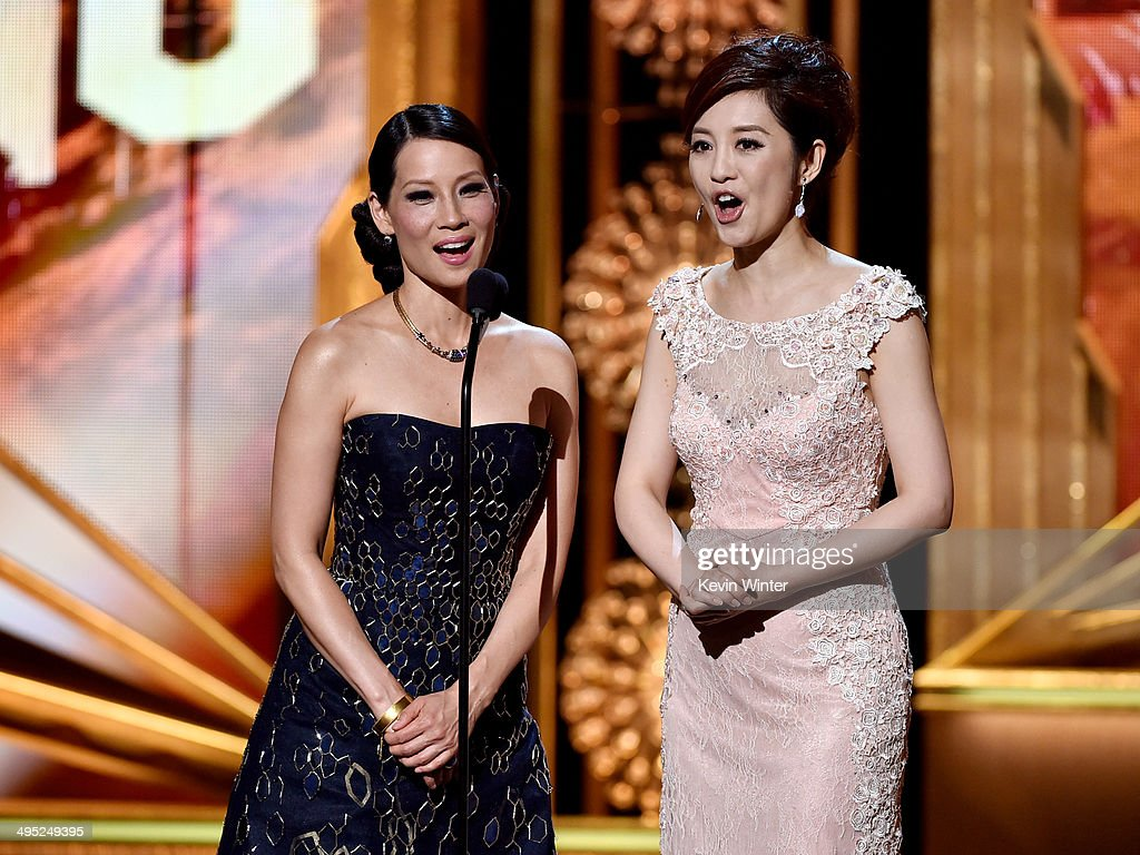 Actresses Lucy Liu (L) and <a gi-track='captionPersonalityLinkClicked' href=/galleries/search?phrase=Olivia+Xu&family=editorial&specificpeople=12752321 ng-click='$event.stopPropagation()'>Olivia Xu</a> appear onstage at the 2014 Huading Film Awards at The Montalban Theatre on June 1, 2014 in Los Angeles, California.