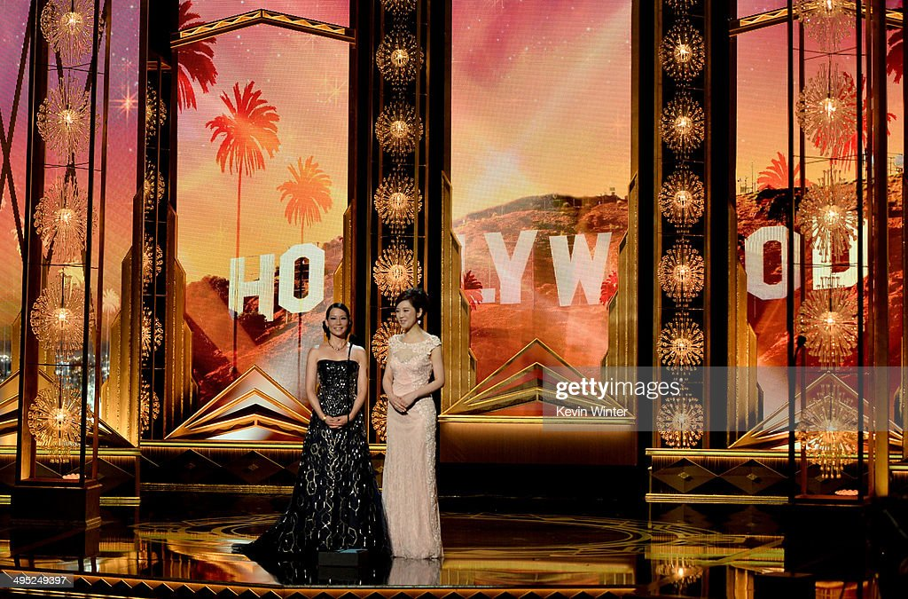 Actresses <a gi-track='captionPersonalityLinkClicked' href=/galleries/search?phrase=Lucy+Liu&family=editorial&specificpeople=201874 ng-click='$event.stopPropagation()'>Lucy Liu</a> (L) and <a gi-track='captionPersonalityLinkClicked' href=/galleries/search?phrase=Olivia+Xu&family=editorial&specificpeople=12752321 ng-click='$event.stopPropagation()'>Olivia Xu</a> appear onstage at the 2014 Huading Film Awards at The Montalban Theatre on June 1, 2014 in Los Angeles, California.