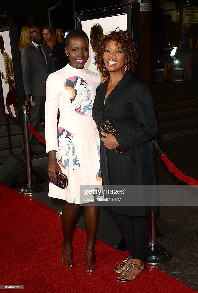 Actresses Lupita Nyong'o (L) and Alfre Woodard arrive at the Los Angeles premiere of '12 Years A Slave' at Directors Guild Of America on October 14, 2013 in Los Angeles, California.