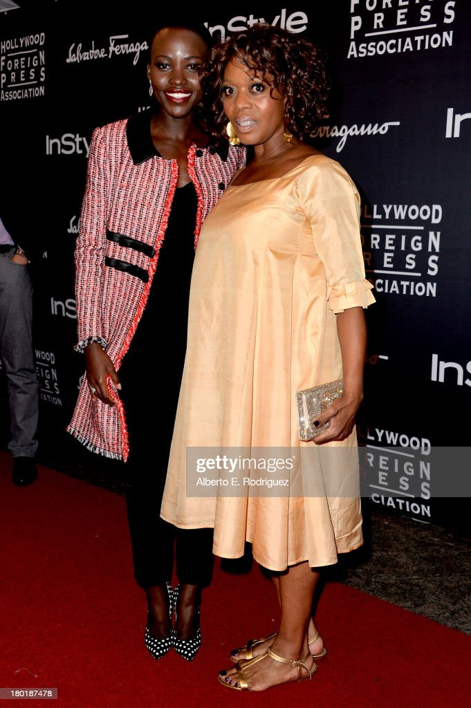 Actresses Lupita Nyong'o (L) and Alfre Woodard arrive at the TIFF HFPA / InStyle Party during the 2013 Toronto International Film Festival at Windsor Arms Hotel on September 9, 2013 in Toronto, Canada.